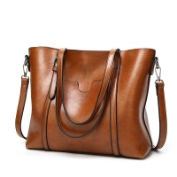 China Classic Styles In Wax PU Leather Handbags Embossed Logo wholesale