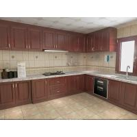 China Wooden Grain Cherry Wood Pvc Villa Kitchen Cabinets Traditional L - Shape For Home wholesale