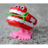 China HOT FUNNY JUMPING TEETH CHATTERING SMILE TEETH SMALL WIND UP FEET TOY wholesale