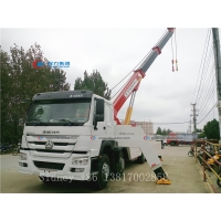 China SINOTRUK HOWO 8x4 Heavy duty 360 Degree Rotation Wrecker truck wrecker equipment recovery rescue and towing truck wholesale
