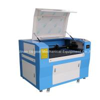 China Hot Sale Advertisement Co2 Laser Engraving Cutting Machine with 900*600mm Size wholesale