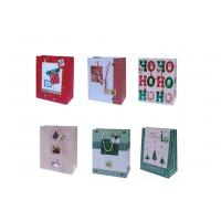 China 210gsm art paepr glossy varnish, embossing, matte Personalized Christmas Gift Bags on sale