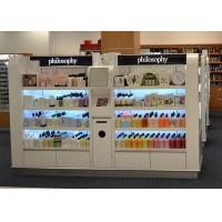 China Wooden Island Shelf Cosmetic Display Case White Coating Decorated With LED Light wholesale