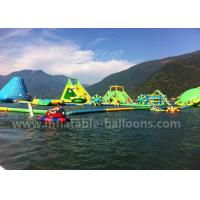 China Green Color Giant Inflatable Water Parks With Tower / Slide Customized Sizes wholesale