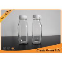 China Fruit Juice 10oz Clear French Square Glass Bottles With Plastic Tearing Off Ring wholesale