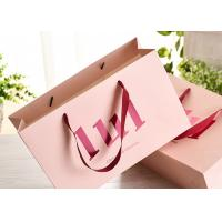 China Ribbon Handle Paper Shopping Bags With Strong Heat Resistant Glue Reinforce wholesale