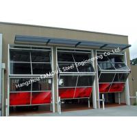 China Non-deforming Aluminum Frame Glass Garage Door Up Clambing Bi Folded Hangar Door With Remote Control wholesale