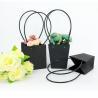 China Waterproof Flower Packaging Carry Kraft Paper Bag With Plastic Handle wholesale