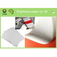 China Good Smoothness White Glossy Art Paper Couch Paper Roll For Printing Magazines wholesale