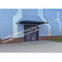China Automatic Glass Sectional Industrial Garage Doors Steel Buildings Kits Superior Weather Resistance wholesale