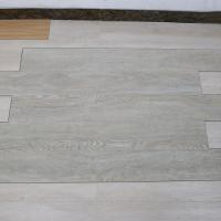 China non deformation wood grain uv coating embossed PVC vinyl flooring planks wholesale