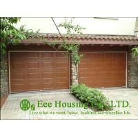 China Galvanized steel Sectional remote-controlled garage door For Condos, Wood color wholesale